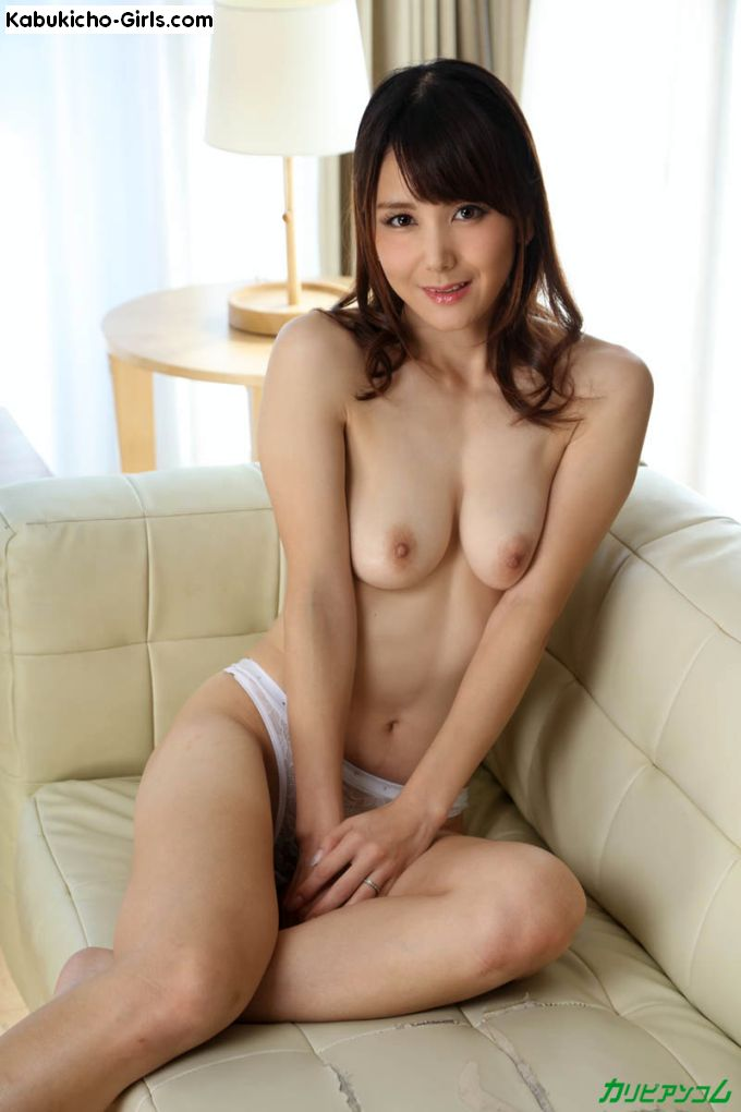 Saori Okumura, ripe boobs exposed, invites us to come closer.